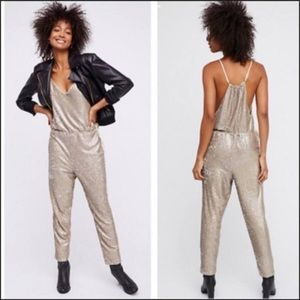Free People gold jumpsuit size small
